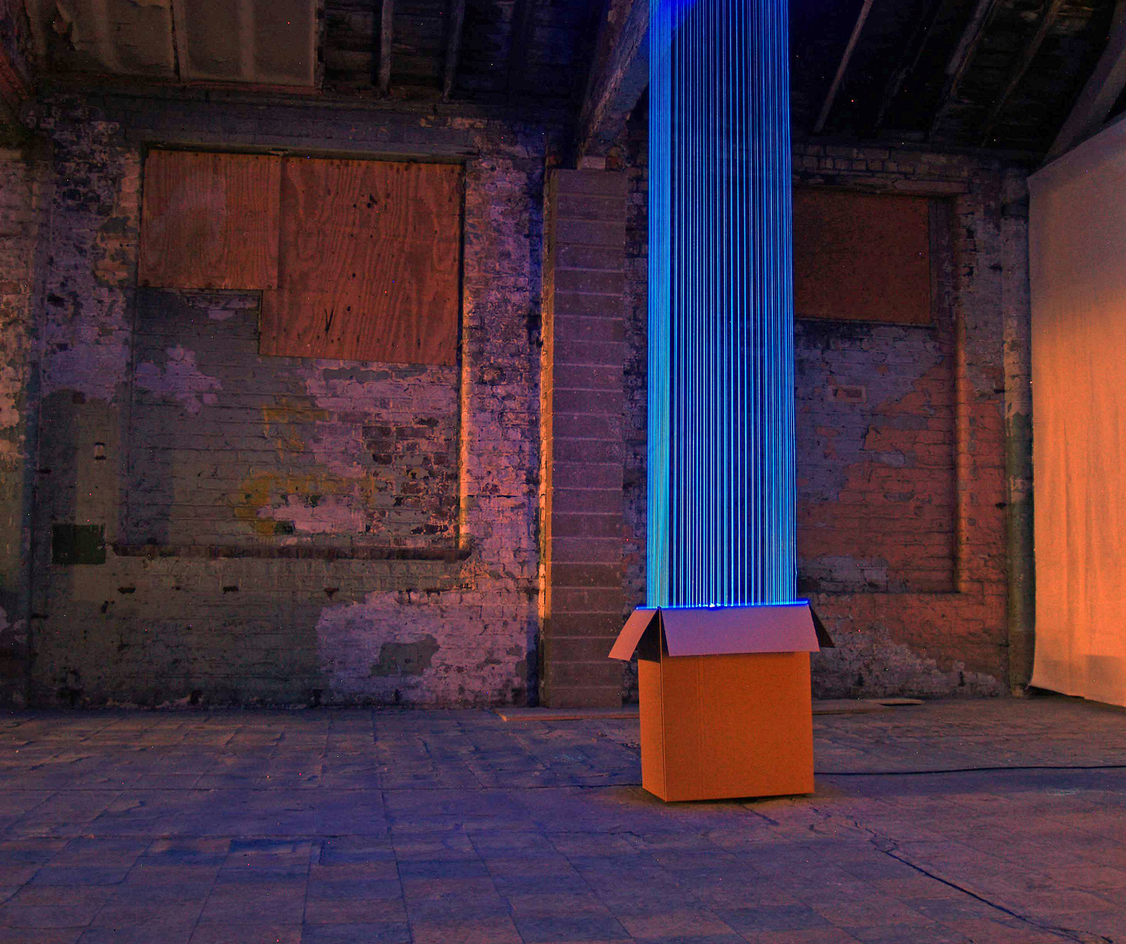 08004 | David Ogle, 2011 | fluorescent fishing line, ultraviolet light, cardboard box | installation view: Soaptank Studios, Warrington | image: courtesy of the artist