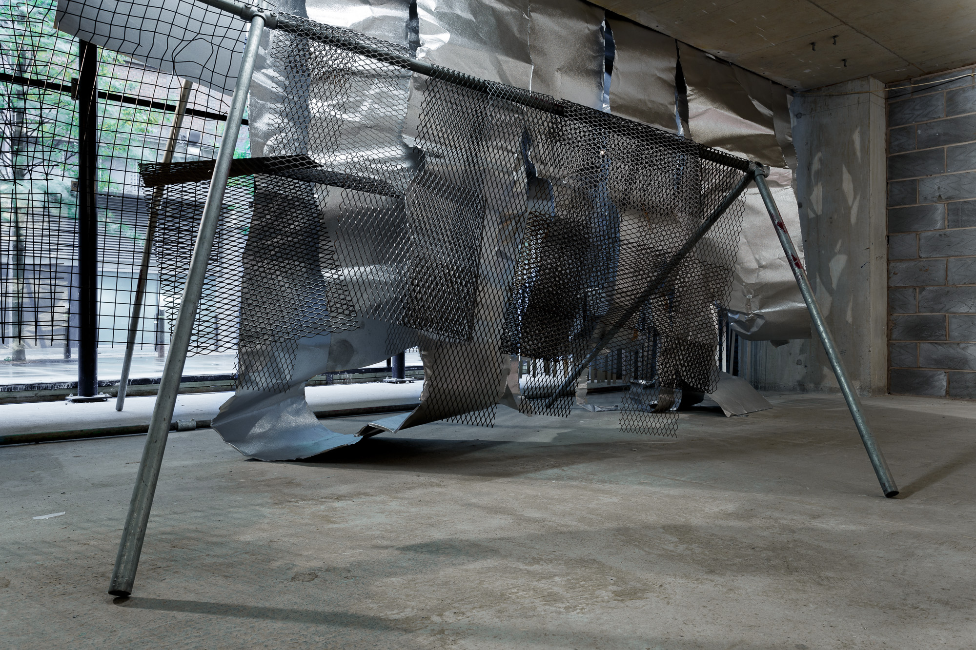 Custom Folds | 2017 | steel, aluminum | site-responsive installation at The Great Medical Disaster, Manchester, UK | dimensions variable | Image: Jules Lister