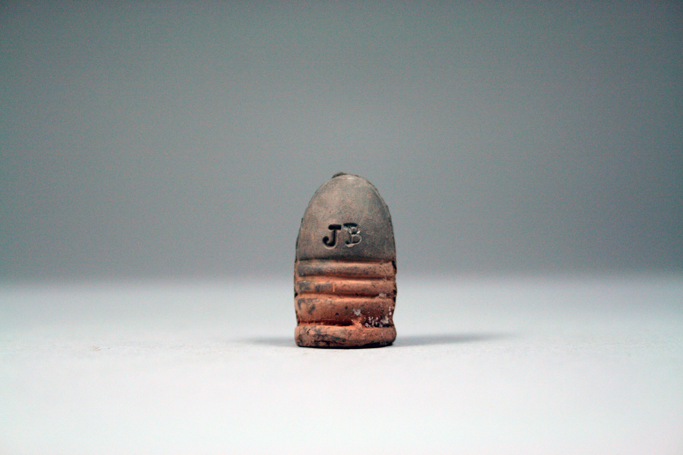 Bury My Heart | James Bloomfield, 2015 | pitfired slip cast ceramic Civil War era bullets | image: courtesy of the artist