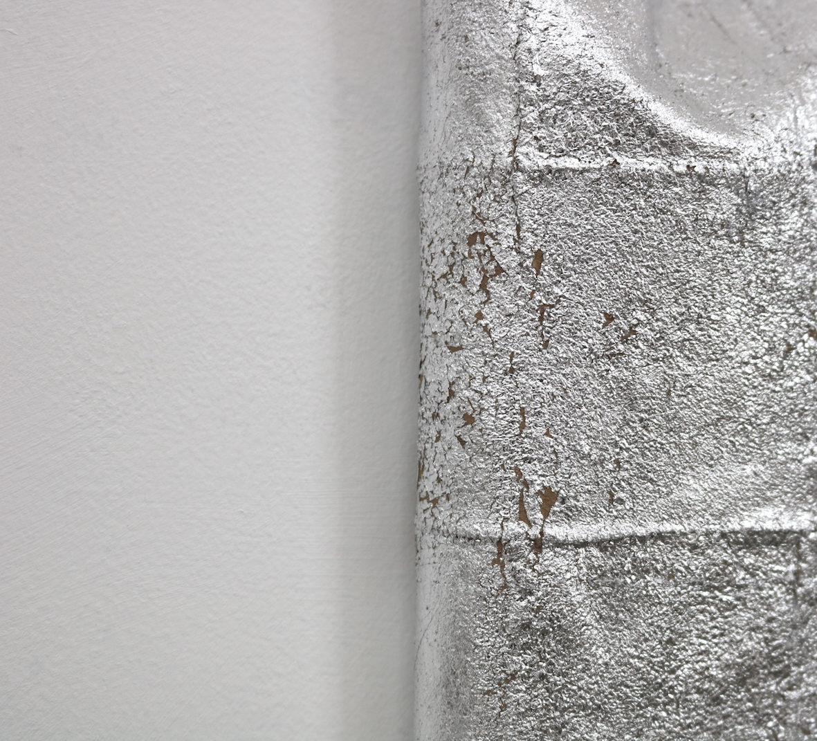 Patch (detail) | Charlie Franklin, 2018 | aluminium leaf, oil, leather, wooden support | 32cm x 18cm x 3cm | image: courtesy of the artist
